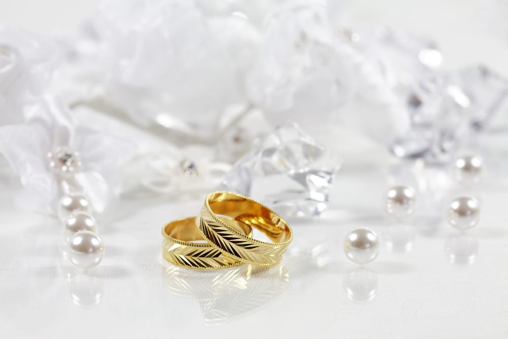 Wedding still life with beautiful golden rings